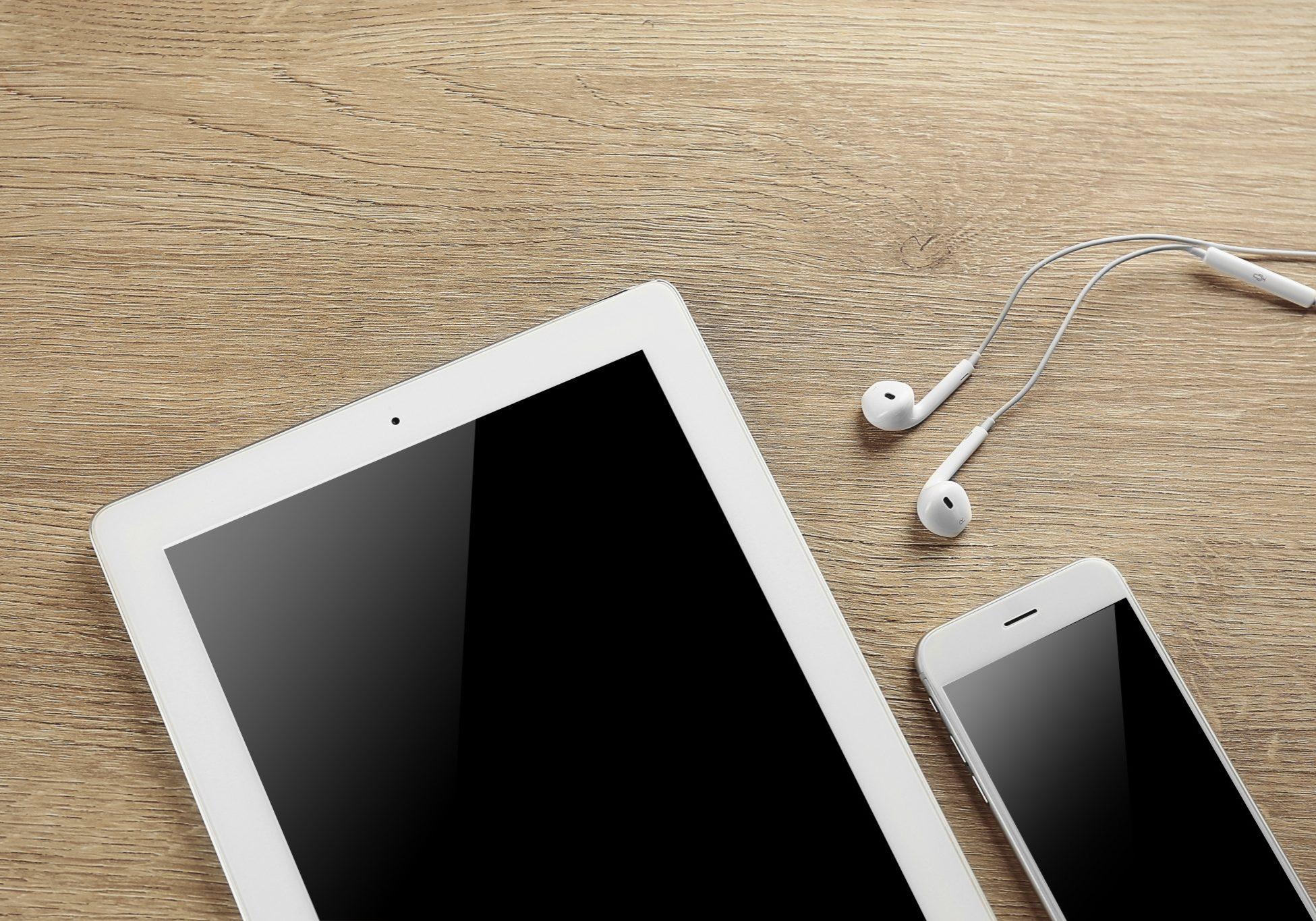 bigstock-Tablet-smartphone-and-earphon-150298394
