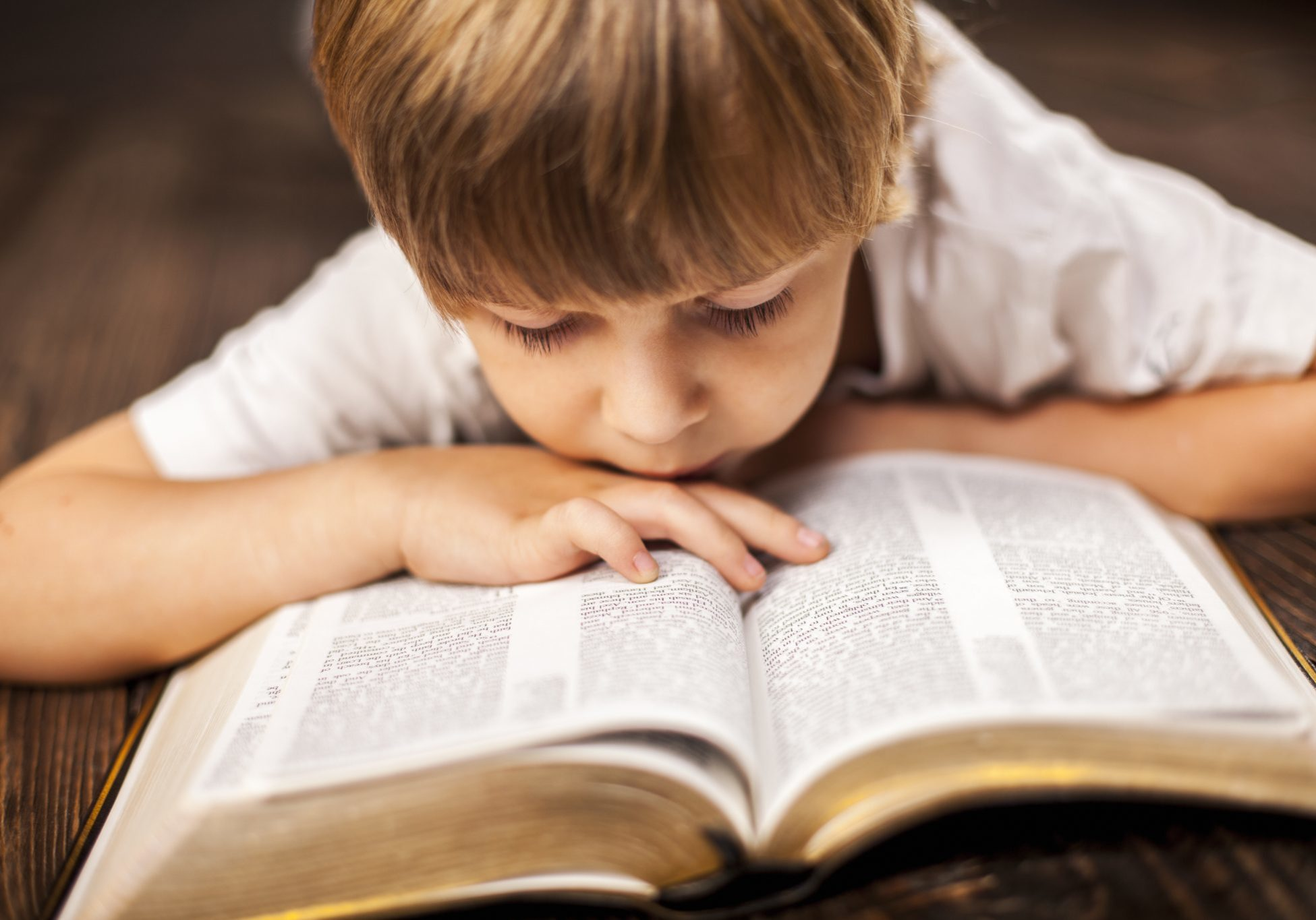 bigstock-little-boy-studying-the-script-80780252